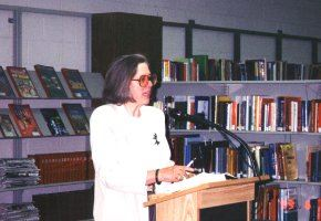 A person stands at a podium